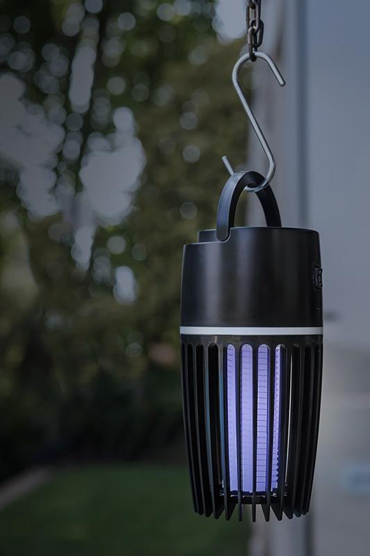 A Skoert Muskiet mosquito killer lamp hanging outside